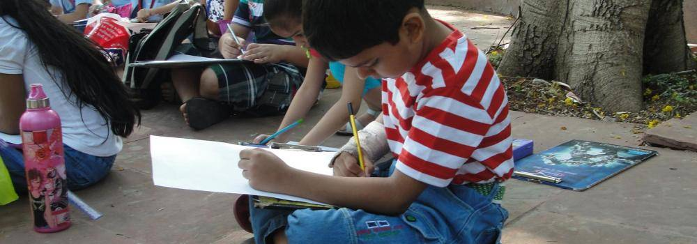 Child drawing outside